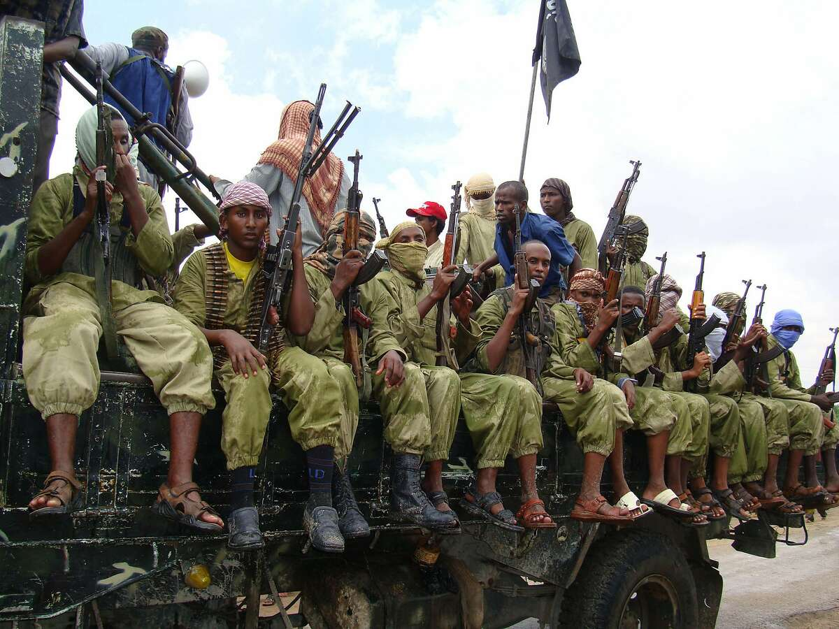 FILE - In this Oct. 30, 2009 file photo, al-Shabab fighters sit on a truck as they patrol in Mogadishu, Somalia. Somalia's intelligence service cooperated with the U.S. in airstrikes that killed more than 150 al-Shabab members on Saturday, an intelligence official said Tuesday, March 8, 2016. The airstrikes targeted a forested military training camp run by the Islamic extremists 200 kilometers (124 miles) north of the capital Mogadishu, the official said, adding that the camp was al-Shabab's main planning base. He said Somali officials helped the U.S. to pinpoint the location of the militants' training base but did not give details. (AP Photo/Mohamed Sheikh Nor, File)