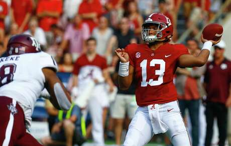 Alabama quarterback Tua Tagovailoa (13) throws a pass against Texas A&M during the first half of an NCAA college football game, Saturday, Sept. 22, 2018, in Tuscaloosa, Ala. (AP Photo/Butch Dill)
