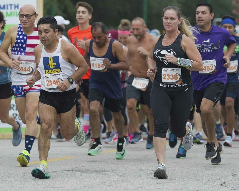 Runners take part in the annual Woodforest Charity Run, Saturday, Sept. 22, 2018, in downtown Conroe. Photo: Jason Fochtman, Houston Chronicle / Staff Photographer / © 2018 Houston Chronicle
