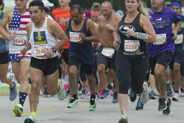 Runners take part in the annual Woodforest Charity Run, Saturday, Sept. 22, 2018, in downtown Conroe.