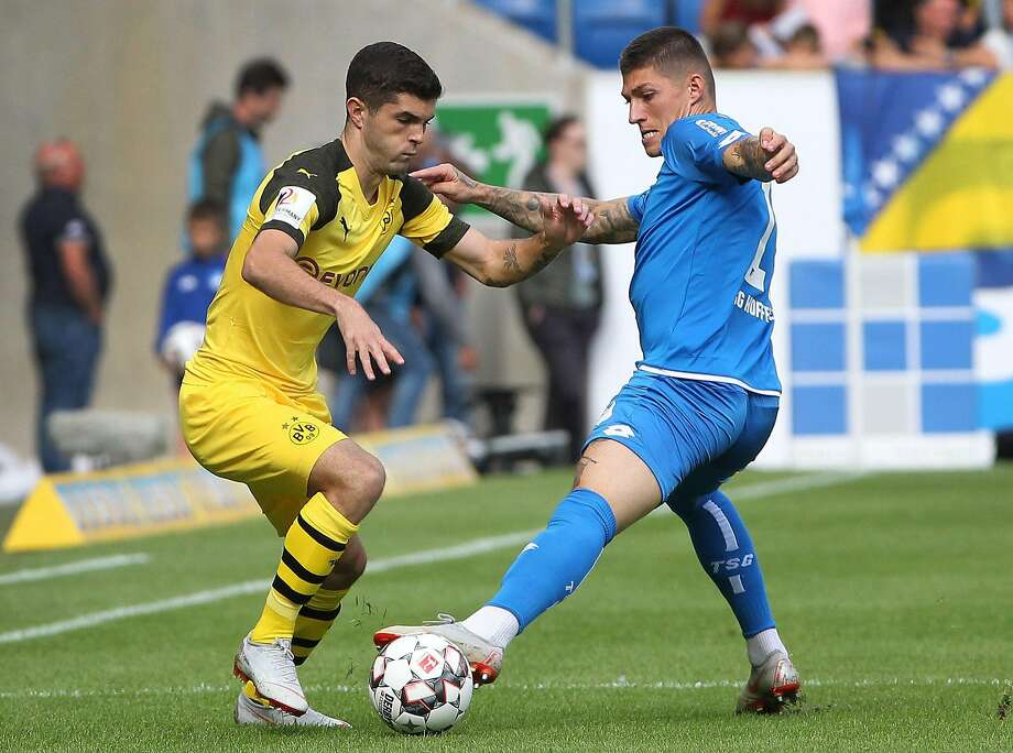 Borussia Dortmund and U.S. national team forward Christian Pulisic eludes Hoffenheim's Steven Zuber on Saturday. Photo: Daniel Roland / AFP / Getty Images