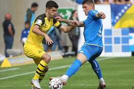 Hoffenheim's Swiss midfielder Steven Zuber (R) and Dortmund's US midfielder Christian Pulisic vie for the ball during the German First division Bundesliga football match TSG 1899 Hoffenheim vs Borussia Dortmund in Sinsheim Germany, on September 22, 2018. (Photo by Daniel ROLAND / AFP) / DFL REGULATIONS PROHIBIT ANY USE OF PHOTOGRAPHS AS IMAGE SEQUENCES AND/OR QUASI-VIDEODANIEL ROLAND/AFP/Getty Images