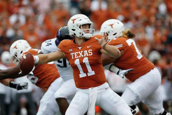 AUSTIN, TX - SEPTEMBER 22: Sam Ehlinger #11 of the Texas Longhorns throws a pass under pressure by Corey Bethley #94 of the TCU Horned Frogs in the second quarter at Darrell K Royal-Texas Memorial Stadium on September 22, 2018 in Austin, Texas.