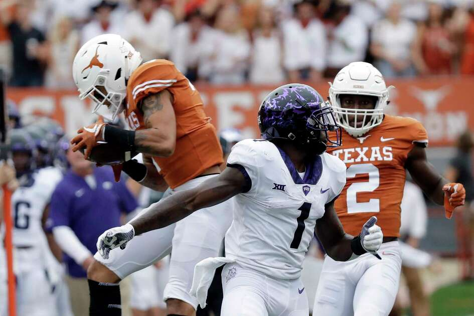 Texas defensive back Caden Sterns, left, intercepts a pass intended for TCU wide receiver Jalen Reagor (1) during the first half of an NCAA college football game, Saturday, Sept. 22, 2018, in Austin, Texas. (AP Photo/Eric Gay)