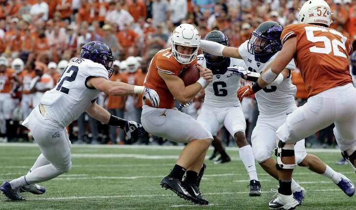 Texas quarterback Sam Ehlinger (11) is pressured by TCU linebacker Ty Summers (42) during the first half of an NCAA college football game, Saturday, Sept. 22, 2018, in Austin, Texas. (AP Photo/Eric Gay)
