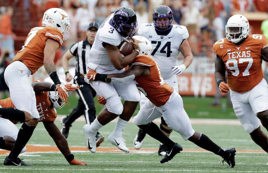 TCU quarterback Shawn Robinson (3) is hit by Texas defensive back Chris Brown (15) on a keeper run during the first half of an NCAA college football game, Saturday, Sept. 22, 2018, in Austin, Texas. (AP Photo/Eric Gay) Photo: Eric Gay, Associated Press / Copyright 2018 The Associated Press. All rights reserved.