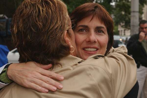 """Rosemary Serra, sister of Concetta """"Penney"""" Serra , is hugged while leaving New Haven Superior Court after her sister's murderer Edward Grant, 59, of Waterbury was sentenced 20 years-to-life for the crime."""