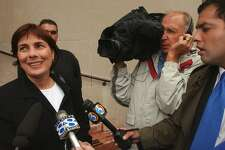 """In this 2002 file photo, Rosemary Serra, sister of Concetta """"Penney"""" Serra , is interviewed by the press while leaving New Haven Superior Court after her sister's killer Edward Grant, 59, of Waterbury was sentenced to 20 years-to-life for the crime. Penney Serra was murdered in a New Haven parking garage in 1973. Grant had no known connection with Serra, but in 1997, a computer check of a police fingerprint database matched his fingerprint with one found at the scene of the crime. Later DNA evidence found near the scene of the crime also tied the crime to Grant."""