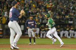 OAKLAND, CA - SEPTEMBER 21: Mark Canha #20 of the Oakland Athletics trots around the bases after hitting a two-run home run off of Gabriel Moya #58 of the Minnesota Twins in the bottom of the six inning at Oakland Alameda Coliseum on September 21, 2018 in Oakland, California. (Photo by Thearon W. Henderson/Getty Images)