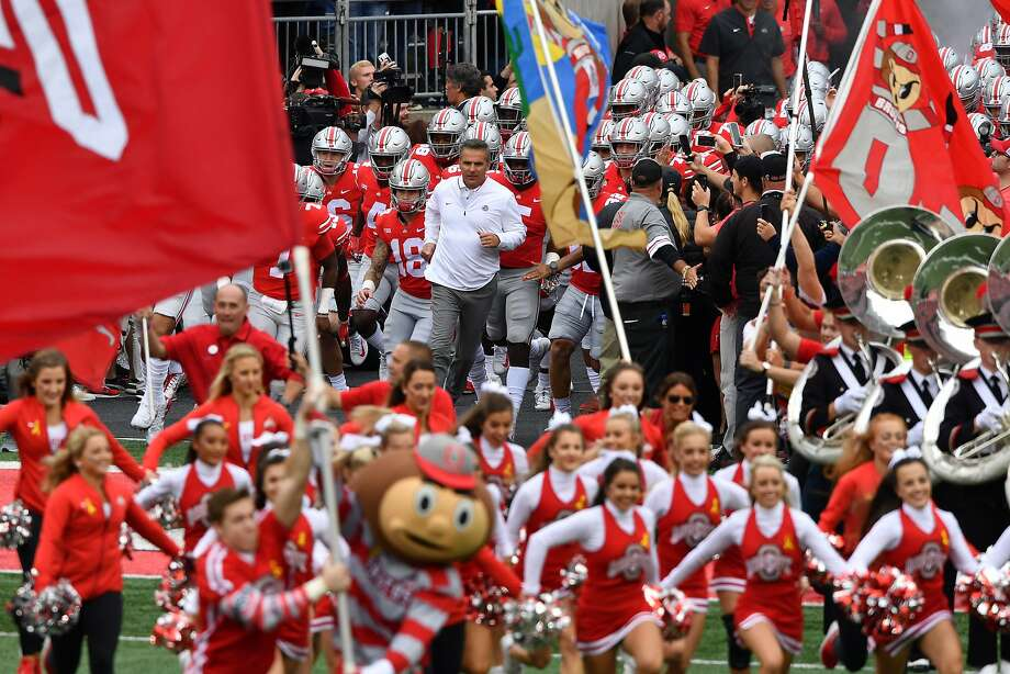Ohio State head coach Urban Meyer (middle, in white) takes the field for the first time this season for the Buckeyes after serving a three-game suspension. Photo: Jamie Sabau / Getty Images