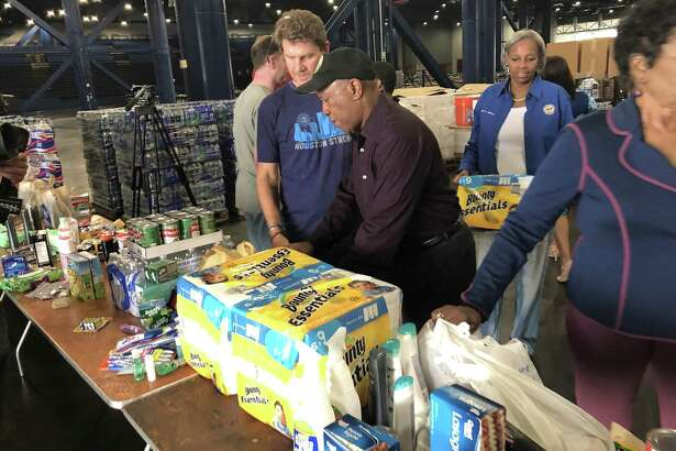 Houston Mayor Sylvester Turner stops by the George R. Brown Convention Center on Saturday afternoon, where volunteers were collecting donations to send to victims of Hurricane Florence.