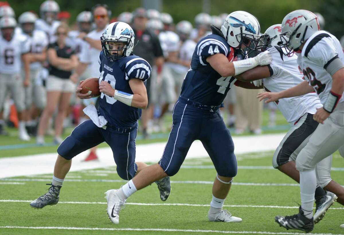 Warrior QB #10 Kyle Phillips makes and end run as the Wilton High School Warriors take on the Fairfield Warde High School Mustangs Saturday, September 22, 2018, in Wilton, Conn.