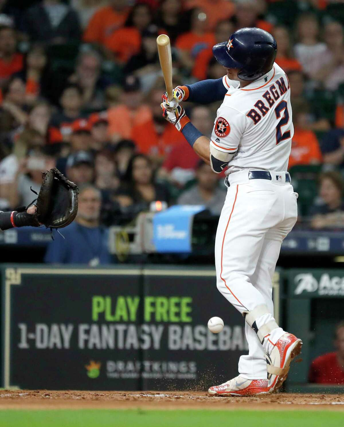 Houston Astros Alex Bregman (2) gets hit by a pitch during the first inning of an MLB baseball game at Minute Maid Park, Saturday, September 22, 2018, in Houston.