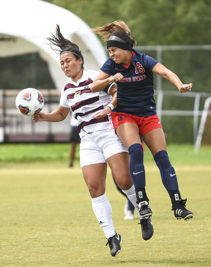 Texas A& International University Valeria Macias headbutts the ball during a game against Rogers State University on Saturday, Sept. 22, 2018 at the TAMIU Soccer Complex. Photo: Danny Zaragoza /Laredo Morning Times