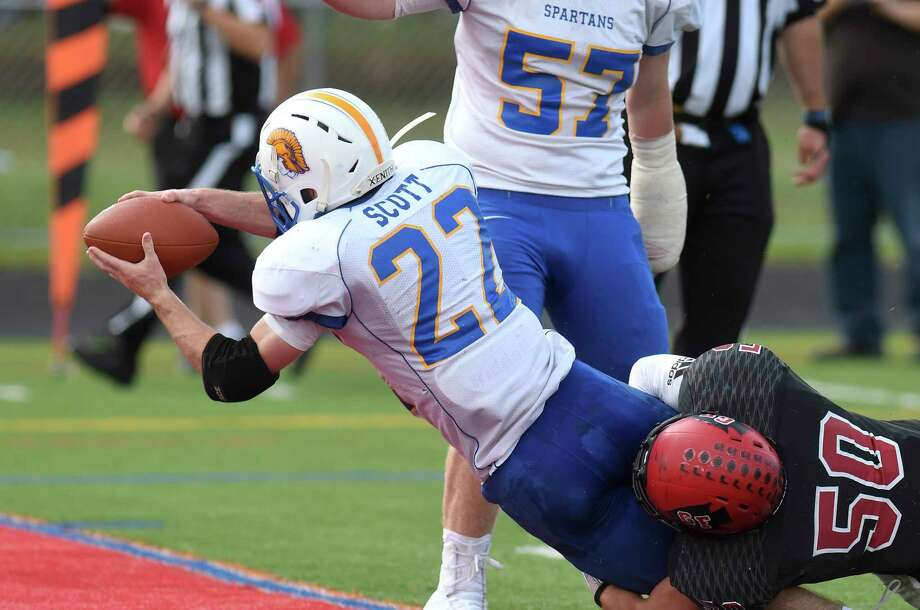 Brendan Scott (22) scores a touchdown while being defended by Queensbury's Connor Girard (50) during a Section II High School football game Saturday, Sept. 22, 2018, in Glens Falls, N.Y. Photo: Hans Pennink, Times Union / Hans Pennink