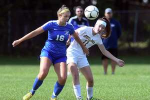 Saratoga's Emma Wrobel (16) and Averill Park's Hannah Ryan (11) battle for the ball during a Section II High School girls' soccer game Saturday, Sept. 22, 2018, in Saratoga Springs, N.Y.