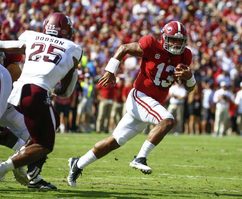 Alabama quarterback Tua Tagovailoa (13) scrambles for a first down against Texas A&M during the first half of an NCAA college football game, Saturday, Sept. 22, 2018, in Tuscaloosa, Ala. (AP Photo/Butch Dill) Photo: Butch Dill, FRE / Associated Press / Copyright 2018 The Associated Press. All rights reserved.