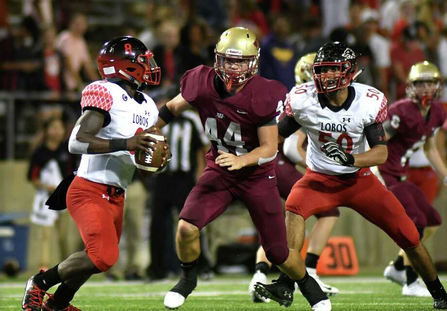 Cy Woods defensive lineman Jason Christenson (44) rushes former Langham Creek quarterback Chris Herron, left, after getting past former Lobo lineman Ibrahim Mohammed (50) during the 2nd quarter of their District 17-6A matchup at Cy-Fair FCU Stadium on Sept. 20, 2018. Photo: Jerry Baker, Houston Chronicle / Contributor / Houston Chronicle