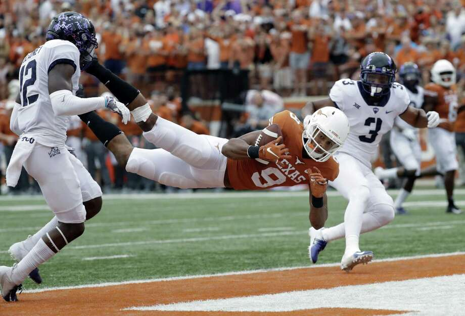 Texas wide receiver Collin Johnson (9) makes a diving catch for a touchdown between TCU defenders Jeff Gladney (12) and TCU safety Markell Simmons (3) during the second half of an NCAA college football game, Saturday, Sept. 22, 2018, in Austin, Texas. (AP Photo/Eric Gay) Photo: Eric Gay, STF / Associated Press / Copyright 2018 The Associated Press. All rights reserved.