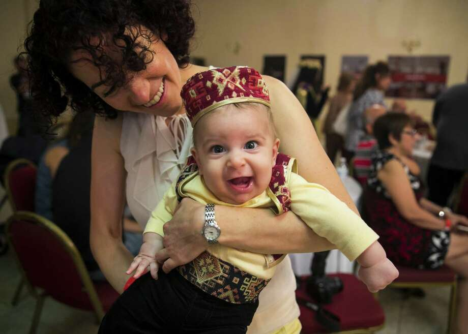 Four-month-old Nicholas Simonian smiles in traditional Armenian clothing in his mother Linda's arms during the 2018 Houston Armenian Festival on Saturday, Sept. 22, 2018, at the Armenian Church of St. Kevork in Houston. Photo: Annie Mulligan / Contributor / © 2018 Annie Mulligan