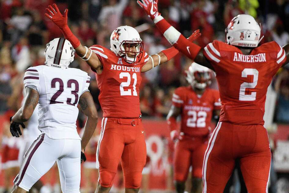 Houston defensive back Gleson Sprewell (21) reacts after breaking up a pass intended for Texas Southern wide receiver Bobby Hartzog Jr. (23) as Keith Corbin (2) watches during the first half of an NCAA college football game, Saturday, Sept. 22, 2018, in Houston.