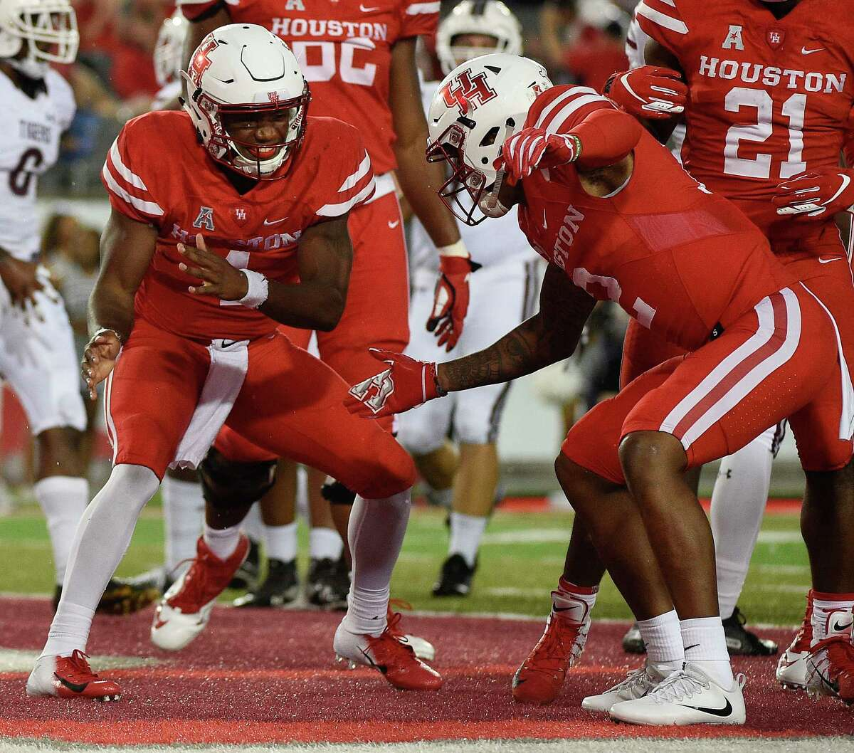 Houston quarterback D'Eriq King, left, celebrates his touchdown with Keith Corbin during the first half of an NCAA college football game against Texas Southern, Saturday, Sept. 22, 2018, in Houston.