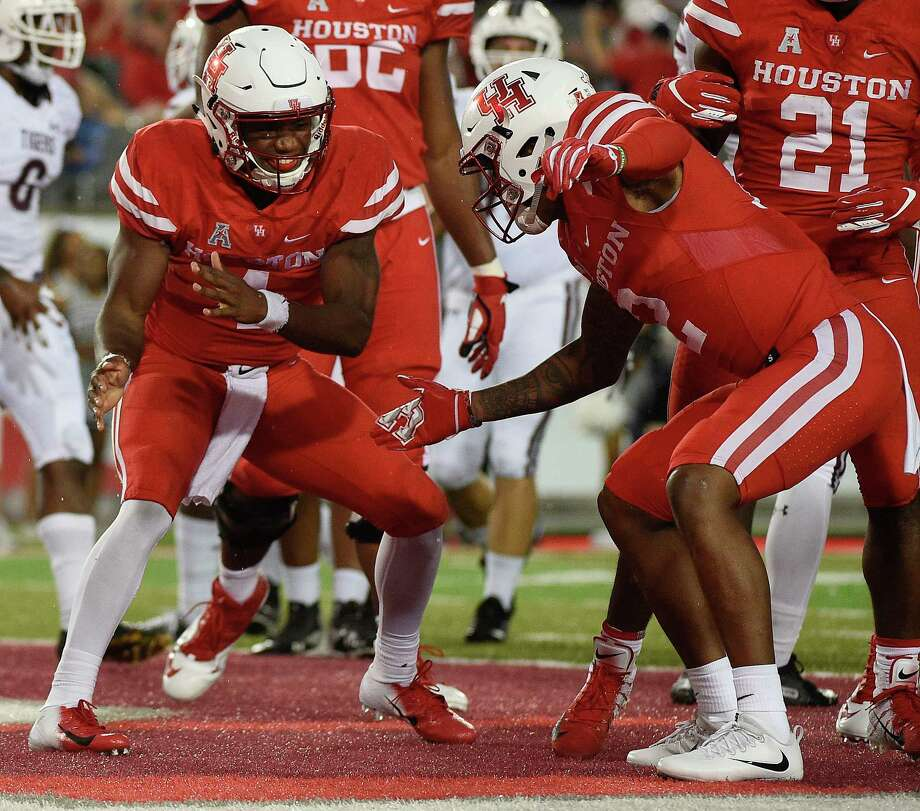 Houston quarterback D'Eriq King, left, celebrates his touchdown with Keith Corbin during the first half of an NCAA college football game against Texas Southern, Saturday, Sept. 22, 2018, in Houston. Photo: Eric Christian Smith, Contributor