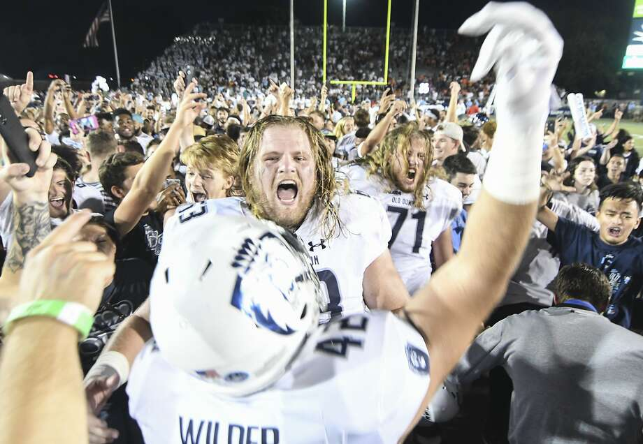 Offensive lineman Nick Clarke leads the Old Dominion on-field celebration after beating Virginia Tech. Photo: Michael Shroyer / Getty Images