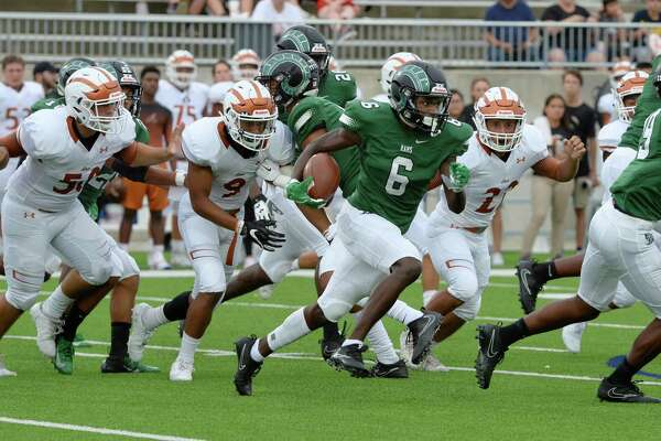 Jalon Strong (6) of Mayde Creek returns Alvin's kickoff for a touchdown as a high school football game starts between the Mayde Creek Rams and the Alvin Yellowjackets on Saturday, September 22, 2018 at Legacy Stadium, Katy, TX.