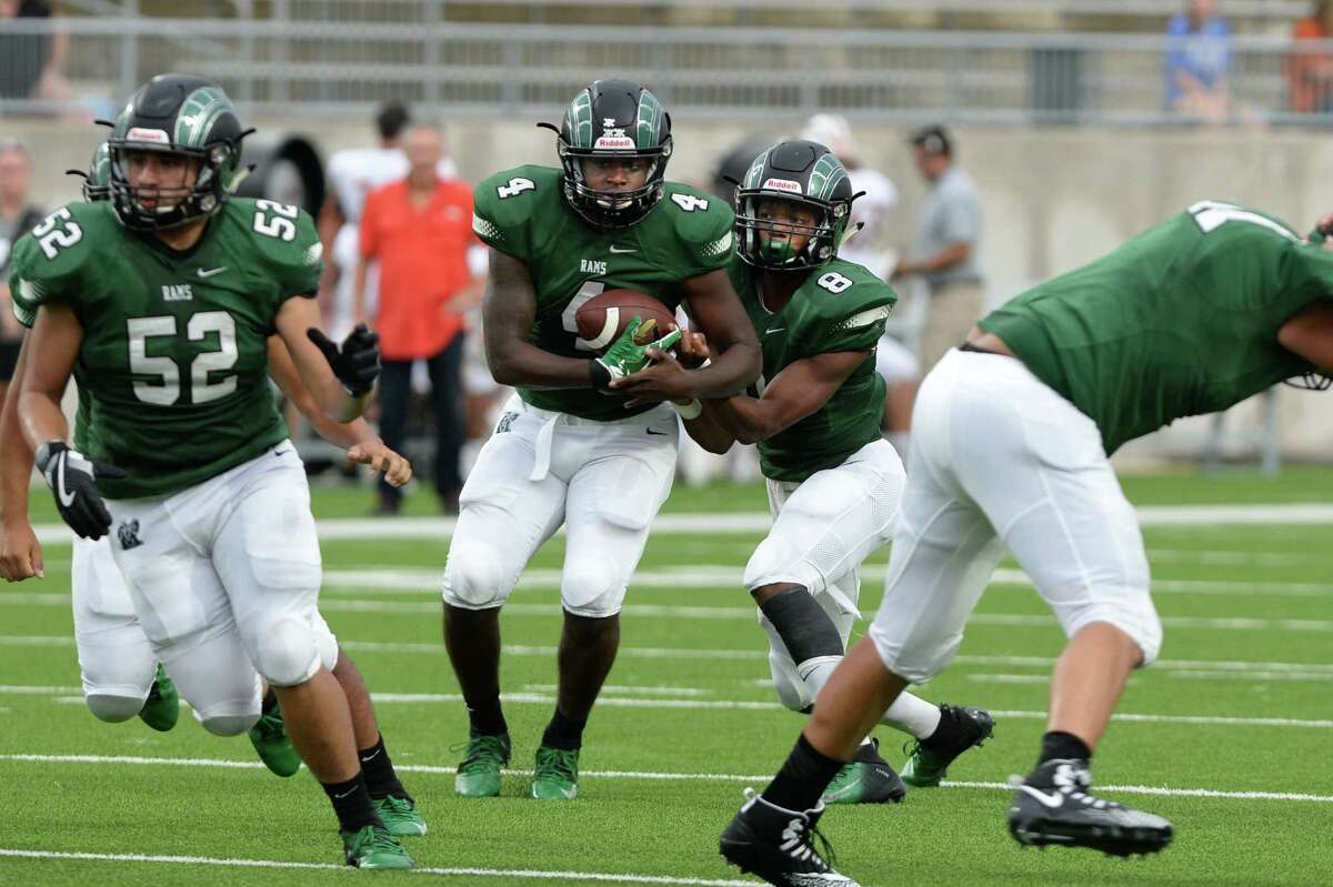 Trevion Goins (4) of Mayde Creek takes a handoff from Jacoby Wilson (8) and scores in the second quarter of a high school football game between the Mayde Creek Rams and the Alvin Yellowjackets on Saturday, September 22, 2018 at Legacy Stadium, Katy, TX.