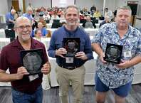 Winners of the inaugural Upstate Crossword Championship tournament, from left, first place winner Michael Landau, of Clifton Park, second place Darrin Conroy of East Greenbush, and third place Timothy Zukas of Burnt Hills pose with their trophies at the Times Union Saturday Sept. 22, 2018 in Colonie, NY.  (John Carl D'Annibale/Times Union)