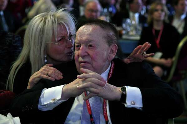 LAS VEGAS, NV - FEBRUARY 24: Dr. Miriam Adelson (L) talks with her husband, Las Vegas Sands Corp. Chairman and CEO Sheldon Adelson, during a speech by U.S. Vice President Mike Pence (not pictured) at the Republican Jewish Coalition's annual leadership meeting at The Venetian Las Vegas on February 24, 2017 in Las Vegas, Nevada. Pence's speech to the group of Republican Jewish leaders and donors follows his trip last week to Germany where he visited the former Dachau concentration camp and a surprise stop on Wednesday at a Jewish cemetery in Missouri that had been vandalized. (Photo by Ethan Miller/Getty Images) ORG XMIT: 700000596