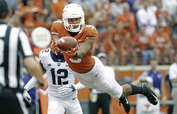 Longhorn wide receiver Collin Johnson catches the touchdown pass which put his team in the lead in the second half as UT beats TCU 31-16 at DKR Stadium on September 22, 2018.