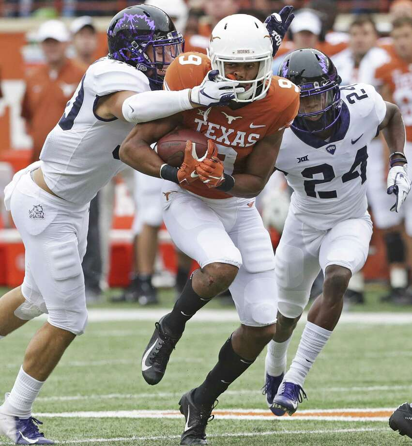 Longhorn receiver Collin Johnson is brought down by a face hold by Garret Wallow as UT hosts TCU at DKR Stadium on September 22, 2018. Photo: Tom Reel, Staff / Staff Photographer / 2017 SAN ANTONIO EXPRESS-NEWS
