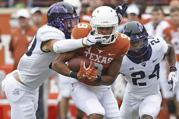 Longhorn receiver Collin Johnson is brought down by a face hold by Garret Wallow as UT hosts TCU at DKR Stadium on September 22, 2018.