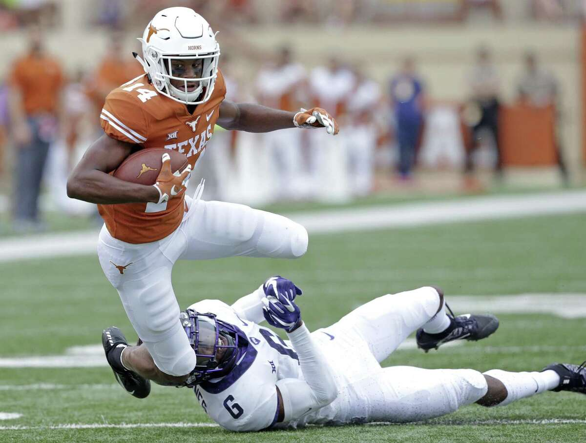Longhorn receiver Joshua Moore pops away from Innis Gaines after a catch as UT hosts TCU at DKR Stadium on September 22, 2018.