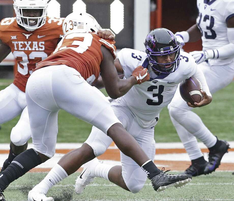 Frog quarterback Shawn Robinson is slung down by Jeffrey McCulloch to stop a scoring threat as UT hosts TCU at DKR Stadium on September 22, 2018. Photo: Tom Reel, Staff / Staff Photographer / 2017 SAN ANTONIO EXPRESS-NEWS