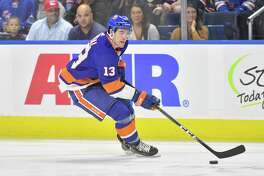 Mathew Barzal (13) of the New York Islanders looks to pass during a pre-season game against the New York Rangers on September 22, 2018 at Webster Bank Arena in Bridgeport, Connecticut.