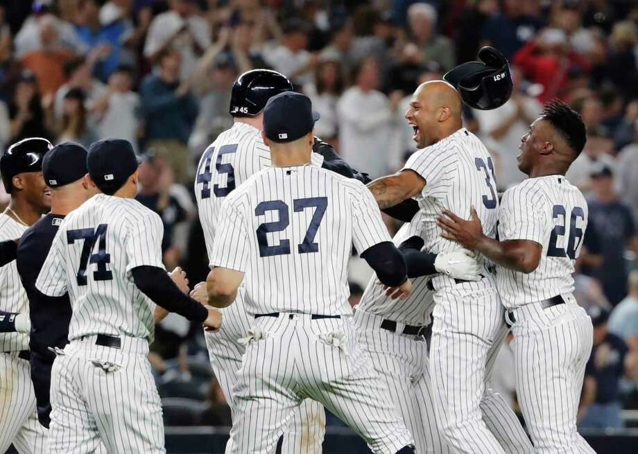 New York Yankees' Aaron Hicks (31) celebrates with teammates after hitting an RBI double during the eleventh inning of a baseball game against the Baltimore Orioles Saturday, Sept. 22, 2018, in New York. The Yankees won 3-2. (AP Photo/Frank Franklin II) Photo: Frank Franklin II / Copyright 2018 The Associated Press. All rights reserved.