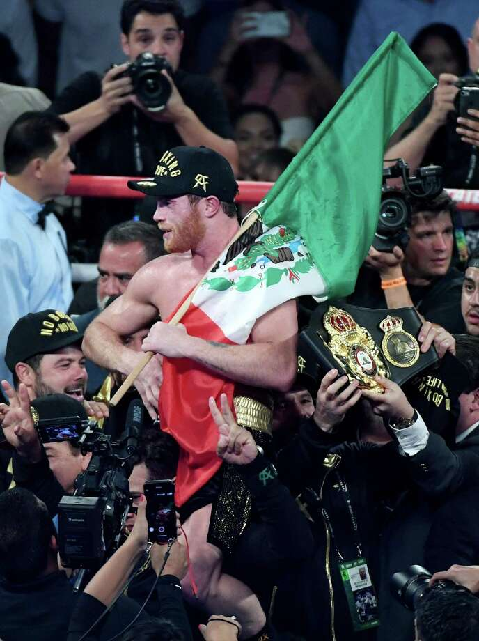 LAS VEGAS, NV - SEPTEMBER 15:  Canelo Alvarez holds a Mexican flag as he celebrates his majority-decision win over Gennady Golovkin after their WBC/WBA middleweight title fight at T-Mobile Arena on September 15, 2018 in Las Vegas, Nevada.  (Photo by Ethan Miller/Getty Images) Photo: Ethan Miller /Getty Images / 2018 Getty Images