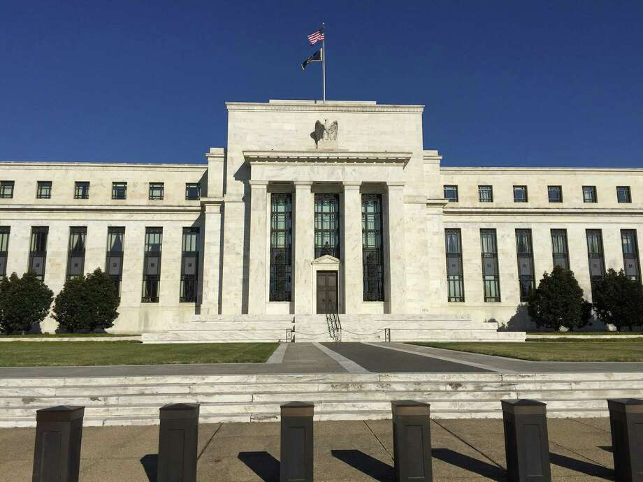A photo taken on Dec. 16, 2015, shows the headquarters of the U.S. Federal Reserve in Washington, D.C. The Fed raised its historically low benchmark interest rate to .25 percent, the first increase in nearly a decade. (Liu Jie/Xinhua/Sipa USA/TNS) Photo: Liu Jie /McClatchy-Tribune News Service / Sipa USA