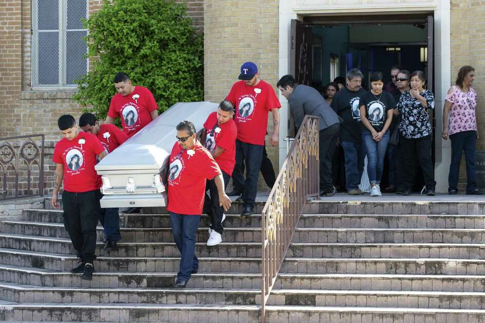 Pallbearers carry the casket of Nikki Enriquez down the steps at Holy Redeemer Catholic Church after her funeral service, Friday, Sept. 21, 2018 in Laredo, Texas. Authorities say Border Patrol supervisor Juan David Ortiz is accused of killing four women this month. He was arrested Sept. 15 and remains jailed on several charges, including four counts of murder. (Courtney Sacco /Corpus Christi Caller-Times via AP)