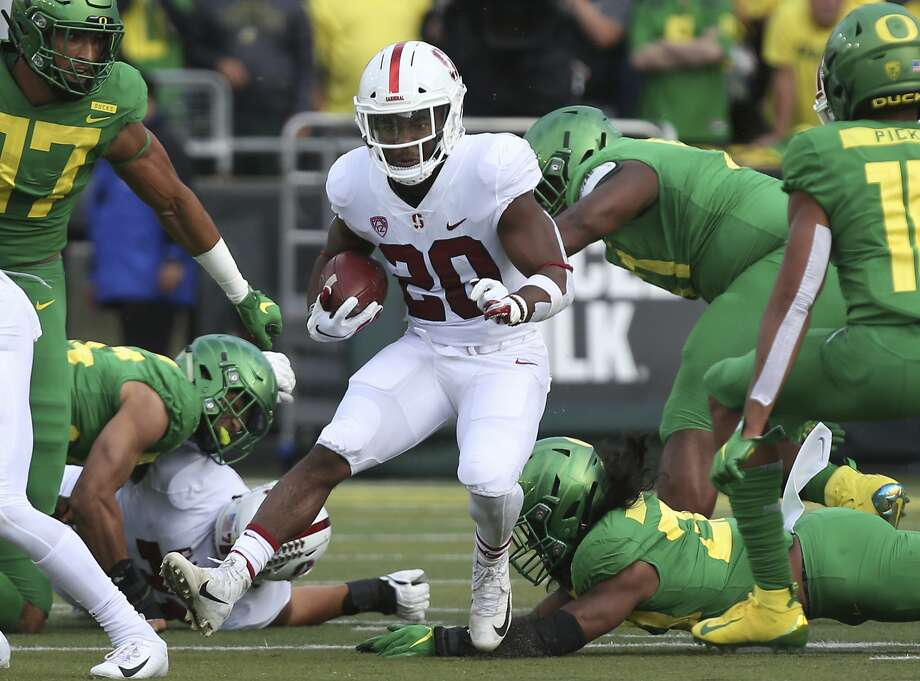 Stanford's Bryce Love, center, runs up the middle against Oregon during the first quarter of an NCAA college football game Saturday, Sept. 22, 2018, in Eugene, Ore. (AP photo/Chris Pietsch) Photo: Chris Pietsch, Associated Press