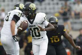 Conroe quarterback Jay Smith (10) looks to pass during the first quarter of a District 15-6A game at Klein Memorial Stadium on Saturday, Sept. 22, 2018, in Spring.
