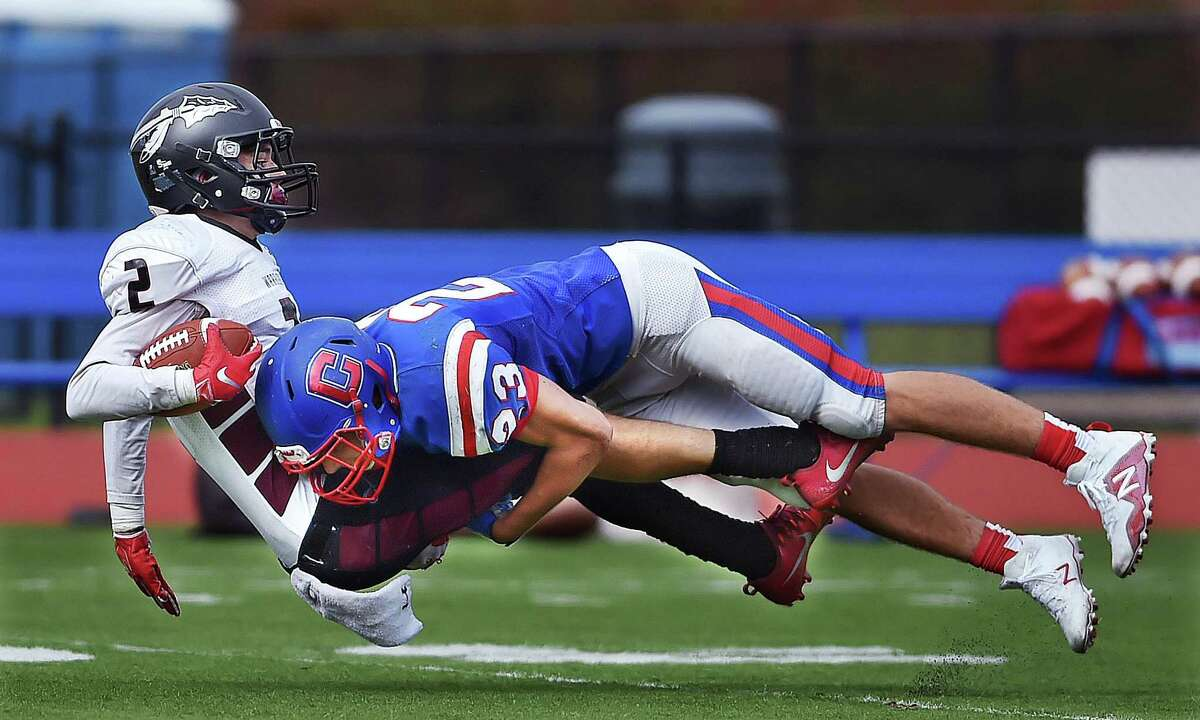 Valley Regional/Old Lyme senior wide receiver Jason O'Brien completes a pass as Coginchaug/Hale Ray/East Hampton senior Ryan Genest makes the tackle Saturday, September 22, 2018, at Coginchaug Regional High School in Durham. Valley Regional/Old Lyme won, 13-0.