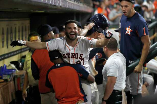 Houston Astros Jose Altuve (27) celebrates his two run home run during the eighth inning of an MLB baseball game at Minute Maid Park, Saturday, September 22, 2018, in Houston.
