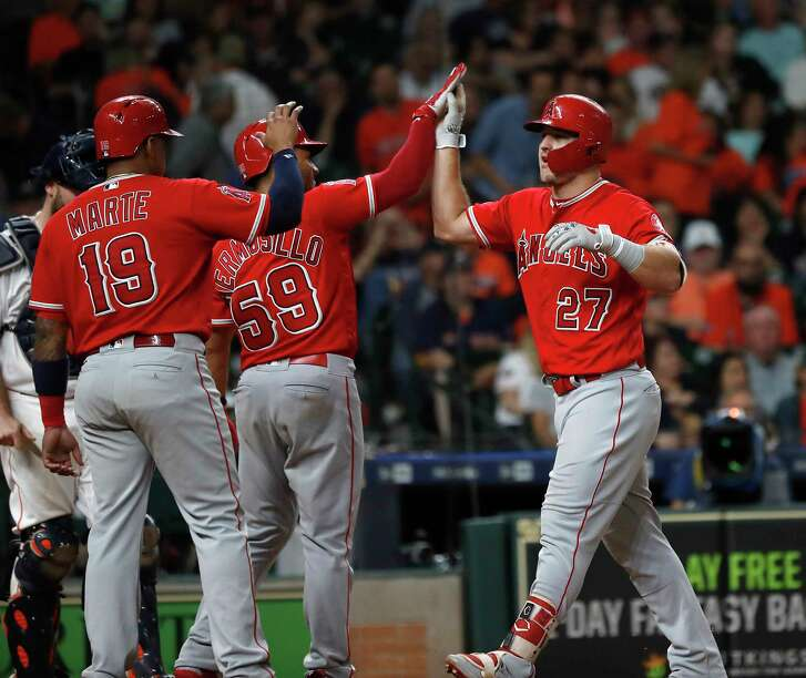 Los Angeles Angels Mike Trout celebrates his home run with teammates during the eighth inning  of an MLB baseball game at Minute Maid Park, Saturday, September 22, 2018, in Houston.