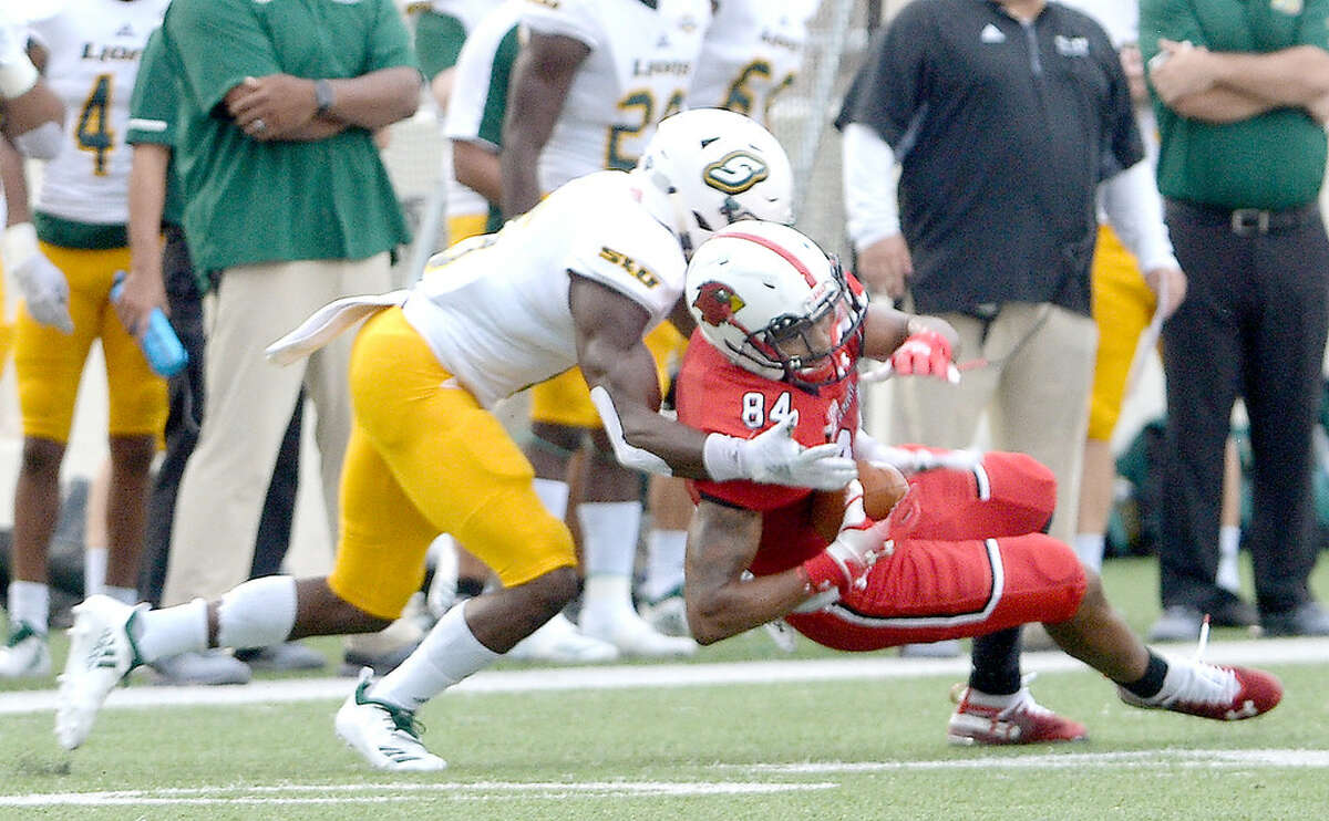 Lamar's Isaiah Howard is brought down by Southeastern Louisiana's Dejion Lynch during Saturday's homecoming game at Provost Umphrey Stadium. Saturday, September 22, 2018 Kim Brent/The Enterprise