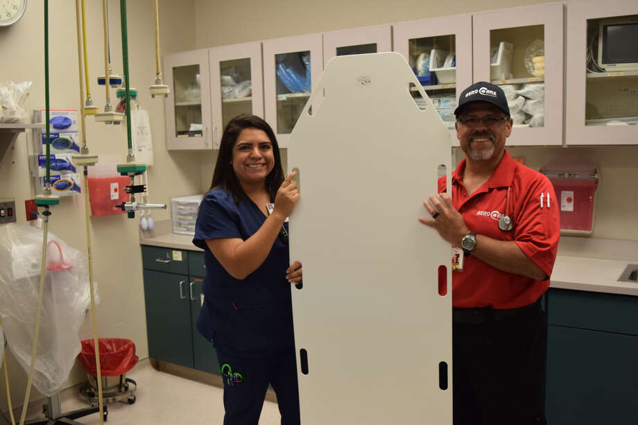 Aerocare paramedic Paul Garza donates his late son's medical equipment to Covenant Health Plainview's Emergency Room. Accepting the kind donation was Covenant Health Plainview's emergency room manager, Melissa Rodriguez. Photo: Homer Marquez/Covenant Health Plainview