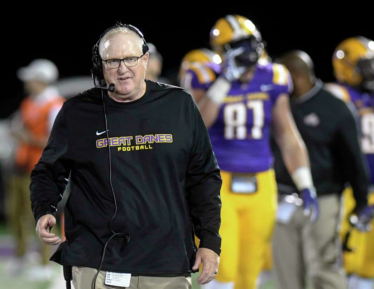 University at Albany head coach Greg Gattuso instructs his players against St. Francis during the first half of an NCAA college football game Saturday, Sept. 22, 2018, in Albany, N.Y.